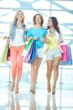 Three shoppers in the mall Royalty Free Stock Photos