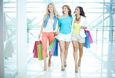 Three shoppers in the mall Royalty Free Stock Photo