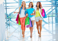 Three shoppers in the mall Stock Photo