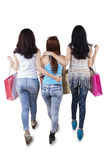 Three shoppers walking in studio Royalty Free Stock Images