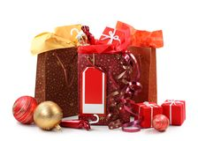 Three shopping bags with presents stock photo