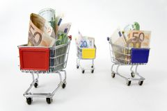 Three Shopping carts with money Royalty Free Stock Image