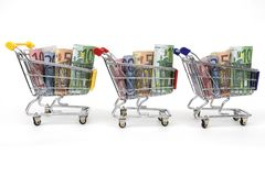 Three Shopping carts with money in a row Stock Images