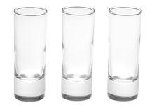 Three shot glasses on white. Three shot glasses isolated on a white background Stock Photography
