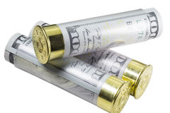Three Shotgun shells loaded with hundred us dollar bills. Three Shotgun shells loaded with hundred us dollar banknotes. Close up image. Selective focus. Concept Stock Photography