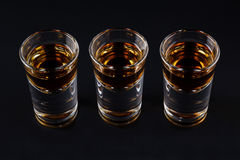 Three shots with cognac or jager on black Stock Photo