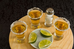 Three shots of gold tequila Stock Photo