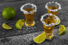 Three shots of gold tequila, vintage toned photo royalty free stock photo