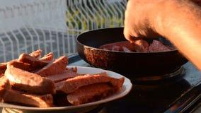 Three shots of preparing sausages. Mix of three shots of preparing sausages stock video