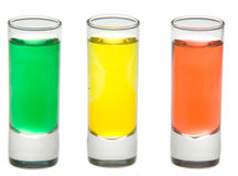 Three shots ready to go. Three different colours isolated on white Royalty Free Stock Photos