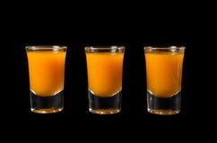Three shots of sea buckthorn drink Stock Photo