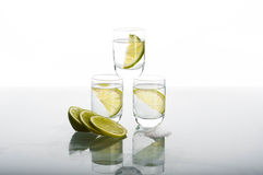 Three shots of vodka with lime Stock Photos