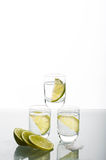 Three shots of vodka with lime Royalty Free Stock Photography
