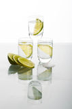 Three shots of vodka with lime Stock Photo