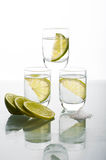 Three shots of vodka with lime Stock Image