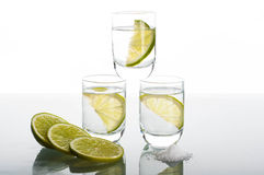 Three shots of vodka with lime Stock Photography