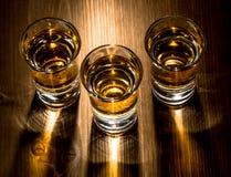 Three shots. Of whiskey on a bar top royalty free stock photos