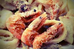 Three shrimp and other fried fish and seafood in the fish restau royalty free stock photos