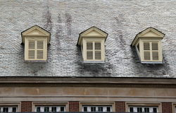 Three shuttered windows on roof Stock Photos