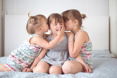 Three sibling sisters  in real interior, lifestyle Stock Photos