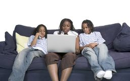 Three siblings on the computer Royalty Free Stock Images