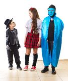 Three siblings dressed up for  Halloween / Purim Royalty Free Stock Image
