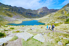 Three siblings hiking to Estany Primer in Tristaina, Andorra Stock Images