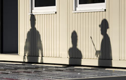 Three silhouette figures. On the container Stock Photo