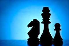 Three silhouetted chess pieces Royalty Free Stock Images