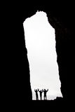 Three silhouettes. In a cave opening Royalty Free Stock Photos