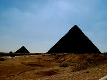 Three silhouettes of pyramids Stock Photos