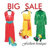 Three silk dresses and open shoes.Fashion boutique Royalty Free Stock Image