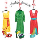 Three  silk dresses and shoeses.Fashion boutique Royalty Free Stock Image
