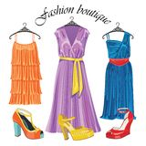 Three  silk dresses with shoeses.Fashion boutique Stock Photo