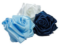 Three silk roses. Blue, blue and white Royalty Free Stock Photos