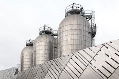 Three silos in stainless steel. Close up of three industrial silos in stainless steel Stock Image