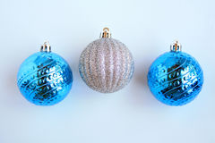 Three silver and blue Christmas Balls. Three Christmas balls on a white background. Two Blue and one silver glitter royalty free stock photography