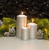 Three Silver Candles Stock Photography