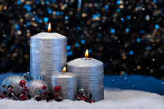Three Silver Candles in snow Stock Image