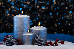 Three Silver Candles in snow Royalty Free Stock Photos