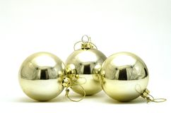 Three silver Christmas decorations. Three silver Christmas baubles in a row Royalty Free Stock Photos