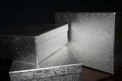 Three silver christmas gift boxes. Silver christmas gift boxes isolated on black background Stock Photos