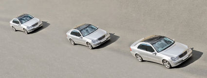 Three similar identical twins cars drive in a line Stock Image