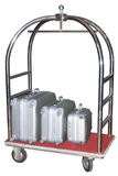 Three similiar suitcases on ho. Tel baggage cart isolated on white background Royalty Free Stock Photo