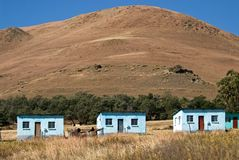 Three simple Basotho Houses. A triplet of simple abodes in the Drakensberg Royalty Free Stock Photo