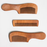 Three simple beautiful wood comb. Royalty Free Stock Photo