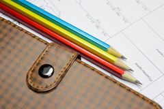 Three simple pencil and notebook on the drawing. Three simple pencil and notebook lying on the drawing Royalty Free Stock Photo