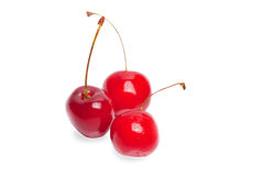 Three single cherries Royalty Free Stock Image