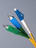 Three single fiber optic connectors Royalty Free Stock Photo