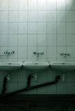 Three sinks. Sinks on ceramic background in soft oil green duotone stock photography